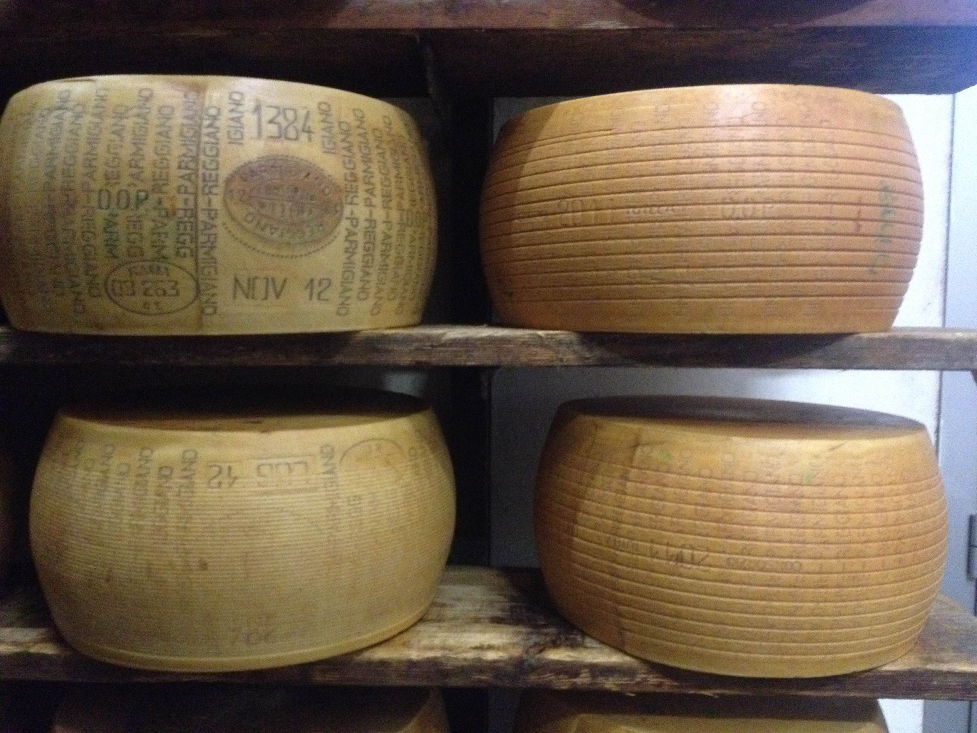 Four_Parmigiano-Reggiano_wheels_with_classifications.JPG